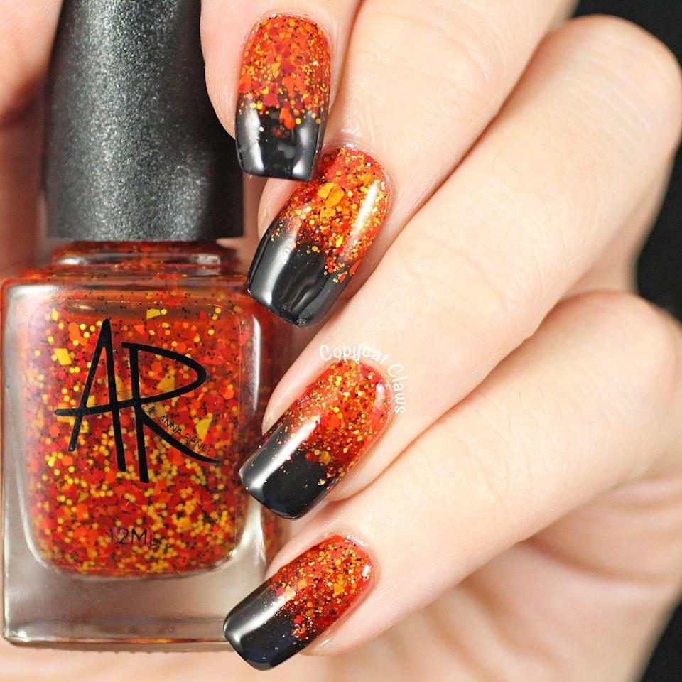 "<p>A glitter gradient amps up the holiday vibes of any Halloween outfit — just make sure to use a great top coat so you don't wind up with little sparkly specks all over your outfit. </p><p><em><a href=""http://copycatclaws.blogspot.com/2014/10/halloween-gradient-nails.html"" rel=""nofollow noopener"" target=""_blank"" data-ylk=""slk:Get the tutorial at Copycat Claws »"" class=""link rapid-noclick-resp"">Get the tutorial at Copycat Claws »</a></em><br> </p>"
