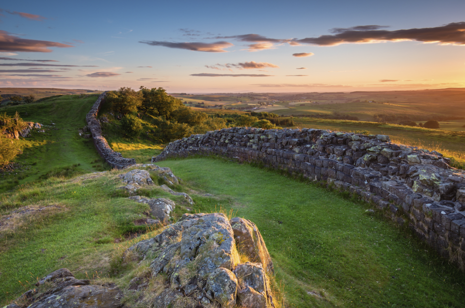 """<p>Another Roman relic, Hadrian's Wall was built to defend the Empire's furthest reaches in 122AD. It spanned around eighty miles of the province of Britannia's northernmost frontier, from the North Sea to the Irish Sea, with castles, barracks, ramparts and forts along the way. A preserved fort to visit today is Housesteads, where visitors can see the foundations of a hospital, barracks and the remains of flushable loos. It's also possible to see the ruins of the bridge that crossed the River Irthing.</p><p><strong>Where to stay:</strong> Fit for a Roman emperor, <a href=""""https://www.langleycastle.co.uk/"""" rel=""""nofollow noopener"""" target=""""_blank"""" data-ylk=""""slk:Langley Castle"""" class=""""link rapid-noclick-resp"""">Langley Castle</a> in Northumberland has nine rooms within the turreted building itself.</p>"""