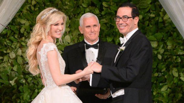 Vice President Mike Pence (C) officiates the wedding of Louise Linton (L) and Secretary of the Treasury Steven Mnuchin (R) on June 24, 2017 at Andrew Mellon Auditorium in Washington, DC. (Kevin Mazur/Getty Images for LS)