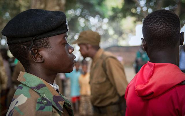 <p>Newly released child soldiers wait in a line for their registration during the release ceremony in Yambio, South Sudan on Feb. 7, 2018. (Photo: Stefanie Glinski/AFP/Getty Images) </p>