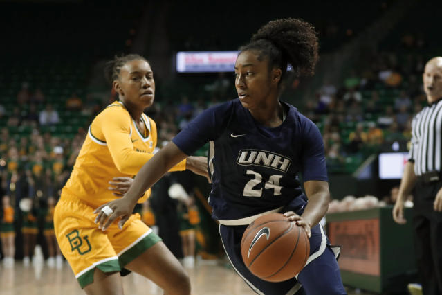 New Hampshire's Helena Delaruelle (24) works to get around the defense of Baylor's Juicy Landrum, left, in the first half of an NCAA college basketball game in Waco, Texas, Tuesday, Nov. 5, 2019. (AP Photo/Tony Gutierrez)
