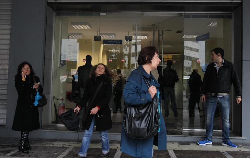 People wait outside an office of Labor Force Employment Organization (OAED) in central Athens, Thursday, Feb. 14, 2013. Unemployment has reached a new record in Greece, with the jobless rate increasing to 27 percent in November 2012. Greece is mired in the sixth year of a deep recession, and has been relying for nearly three years on international rescue loans to keep it afloat. (AP Photo/Thanassis Stavrakis)
