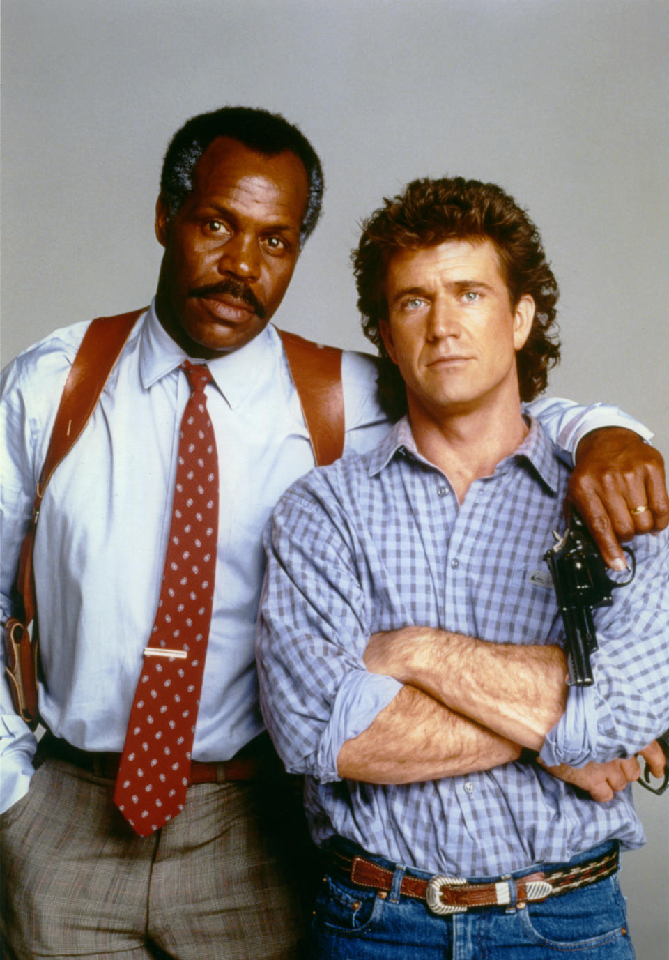 American actor Danny Glover and Australian-American actor Mel Gibson on the set of Lethal Weapon directed by Richard Donner. (Photo by Sunset Boulevard/Corbis via Getty Images)