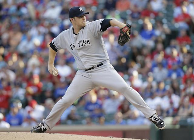 New York Yankees starting pitcher Phil Hughes throws during the first inning of a baseball game against the Texas Rangers on Tuesday, July 23, 2013, in Arlington, Texas. (AP Photo/LM Otero)