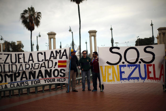 """<span class=""""s1"""">Carlos Molina Tamayo, center, a retired Venezuelan naval admiral and former national security adviser of Hugo Chavez, protests against Venezuelan President Nicolas Maduro's government in Spain, where he was then in exile, in 2014. (Photo: Jon Nazca/Reuters)</span>"""