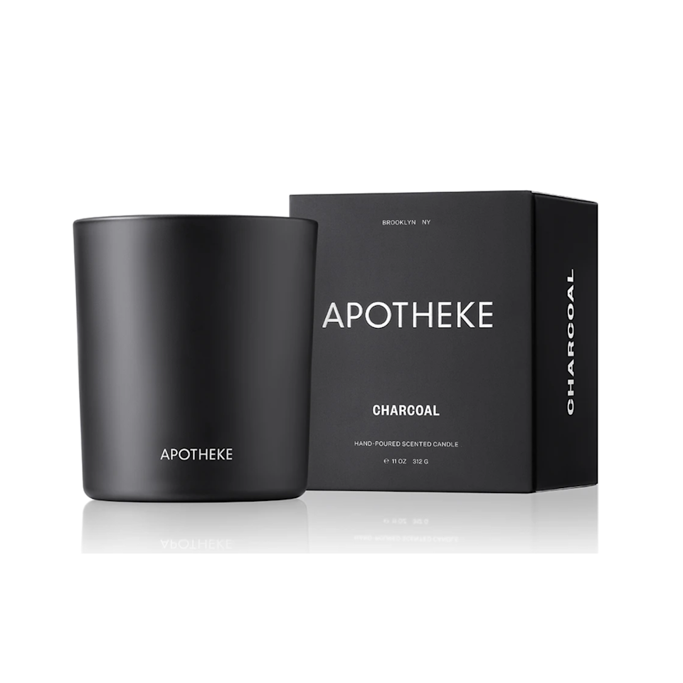"""If you're ready for Halloween, Apotheke's charcoal candle probably uses magic to work in maple, bacon, raspberry and tomato, while adding undertones of clove and cinnamon, hints of embers, cedarwood, and guaiac. The blend gives it that """"I just woke up in my cabin by the lake"""" smell. How a candle can capture the whimsy and comfort of a place in the woods just for yourself, I'm not sure. But I'm buying three of these. $38, Apotheke. <a href=""""https://apothekeco.com/collections/candles-votives-and-3-wicks/products/binchotan-charcoal-candle"""" rel=""""nofollow noopener"""" target=""""_blank"""" data-ylk=""""slk:Get it now!"""" class=""""link rapid-noclick-resp"""">Get it now!</a>"""
