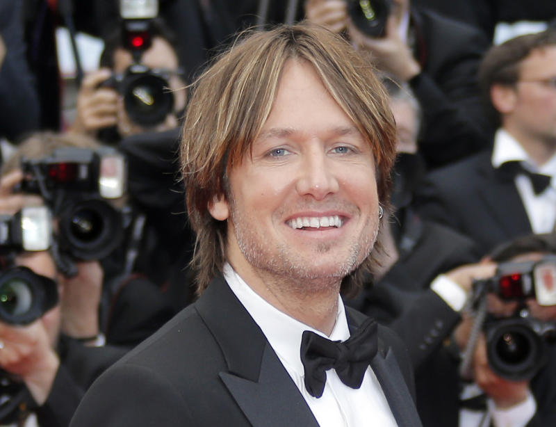 """FILE - In this May 19, 2013 file photo, musician Keith Urban arrives for the screening of the film """"Inside Llewyn Davis"""" at the 66th international film festival, in Cannes, southern France. Fox announced Tuesday, Sept. 3, 2013 that Urban, along with Harry Connick Jr. and Jennifer Lopez, will be judges on the upcoming season of """"American Idol."""" (AP Photo/Lionel Cironneau, File)"""