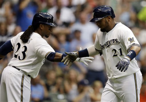 Milwaukee Brewers' Juan Francisco (21) is congratulated by Rickie Weeks (23) after hitting a home run during the fourth inning of a baseball game against the Miami Marlins, Friday, July 19, 2013, in Milwaukee. (AP Photo/Morry Gash)
