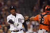 Detroit Tigers' Jonathan Schoop argues his strike call with umpire Ramon De Jesus as Baltimore Orioles catcher Pedro Severino walks off to celebrate the Orioles' 5-2 win after a baseball game, Saturday, July 31, 2021, in Detroit. (AP Photo/Carlos Osorio)