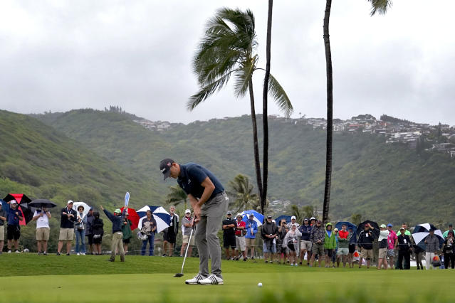 Brendan Steele putts on the first green during the final round of the Sony Open PGA Tour golf event, Sunday, Jan. 12, 2020, at Waialae Country Club in Honolulu. (AP Photo/Matt York)