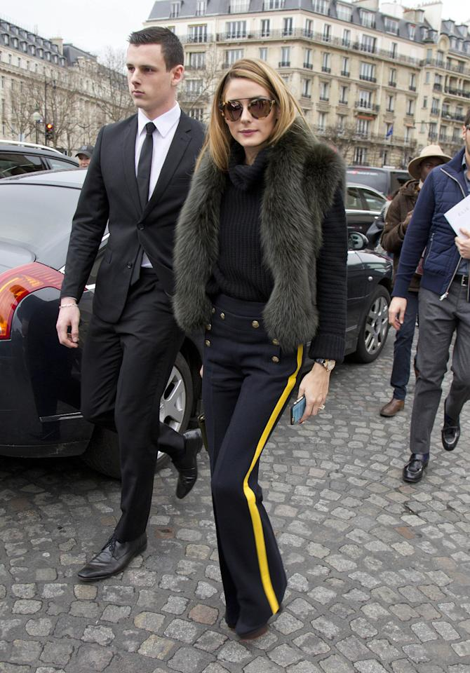 <p>Palermo's pants—that had buttons and yellow tuxedo stripes—were paired perfectly with a navy knit turtleneck sweater and a charcoal colored fur vest. (<i>Splash News</i>)</p>