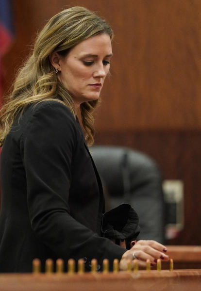 Samantha Knecht, prosecutor, places bullets in front of the jury as she speaks during the sentencing phase for Ronald Lee Haskell Thursday, Oct. 11, 2019 in Houston. A jury has sentenced to death Haskell, who fatally shot six members of his ex-wife's family in Texas. Jurors on Friday, Oct, 11, 2019, decided Haskell would be a future danger to society and rejected arguments by Haskell's attorneys that his history of mental illness should spare him the lethal injection. ( Melissa Phillip/Houston Chronicle via AP) (Melissa Phillip/Houston Chronicle via AP)