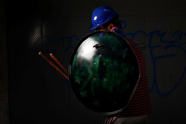 "<p>A demonstrator holding a satellite TV antenna used as a shield poses for a picture before a rally against Venezuelan President Nicolas Maduro's government in Caracas, Venezuela, May 27, 2017. He said: ""I protest for my country… we are the resistance and we are fighting for the world to understand that we live in a dictatorship. I fight for the beautiful Venezuela."" (Photo: Carlos Garcia Rawlins/Reuters) </p>"