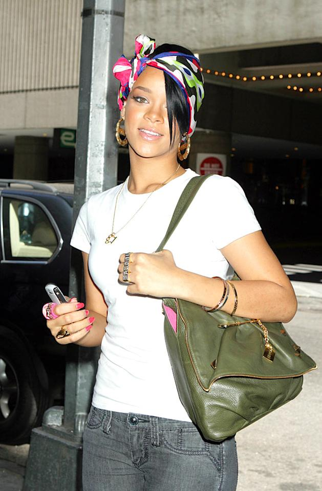 "Rihanna's got a lot going on with the big hoops, big handbag, and big head wrap. Roger Wong/<a href=""http://www.infdaily.com"" target=""new"">INFDaily.com</a> - May 28, 2007"