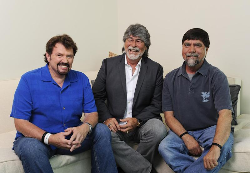 """In this Tuesday, Aug. 13, 2013 photo, Jeff Cook, Randy Owen and Teddy Gentry from the American country music band Alabama pose for a portrait in Nashville, Tenn. Alabama has launched a tour and released a new album this week, """"Alabama & Friends,"""" that features duets of the group's biggest hits with top country stars. (Photo by Donn Jones/Invision/AP)"""