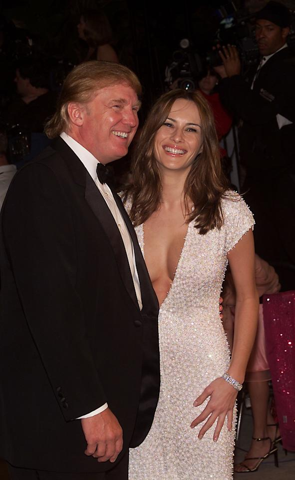 <p>She was still Melania Knauss in 2001, but the future first lady was already making a name for herself with this showstopping white gown. The waist-hugging dress with its plunging neckline was paired with a diamond bracelet. Her soft beach waves and neutral makeup made the look fun and relatable. (Photo: Getty Images) </p>