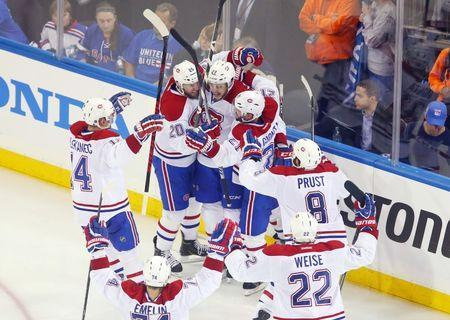 May 22, 2014; New York, NY, USA; Montreal Canadiens center Alex Galchenyuk (27) celebrates with his teammates after scoring the game-winning goal against the New York Rangers during the overtime period in game three of the Eastern Conference Final of the 2014 Stanley Cup Playoffs at Madison Square Garden. Ed Mulholland-USA TODAY Sports