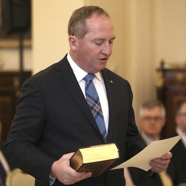 In this July 19, 2016, file photo Australia's Deputy Prime Minister Barnaby Joyce takes the oath of office as he is sworn in at Government House in Canberra, Australia. Joyce, on Monday, Aug. 14, 2017, became the latest lawmaker to reveal he might have breached a constitutional prohibition on dual citizens becoming lawmakers, after he was advised by the New Zealand government that he might be a kiwi. (AP Photo/Rob Griffith, File)