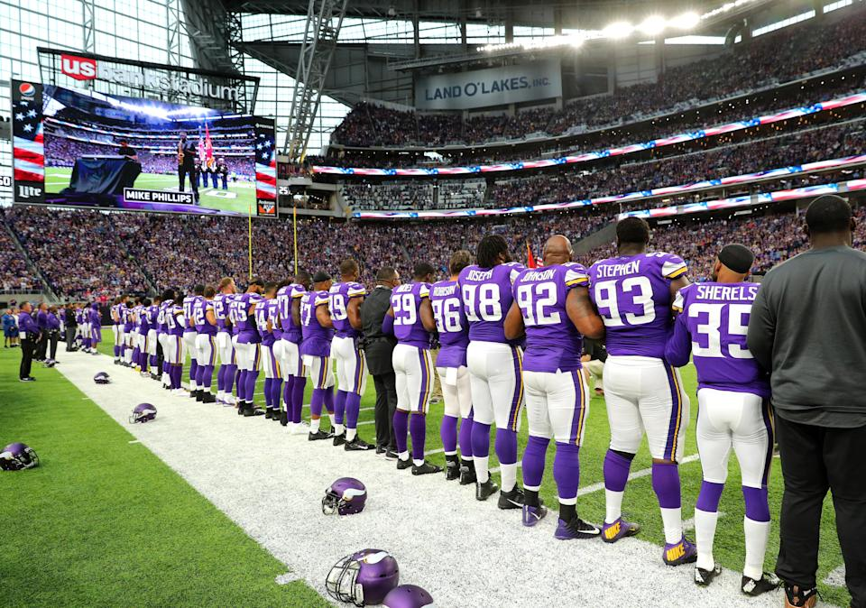 Vikings players link arms during the national anthem before their game against the Lions on Oct. 1 in Minneapolis. (Getty Images)