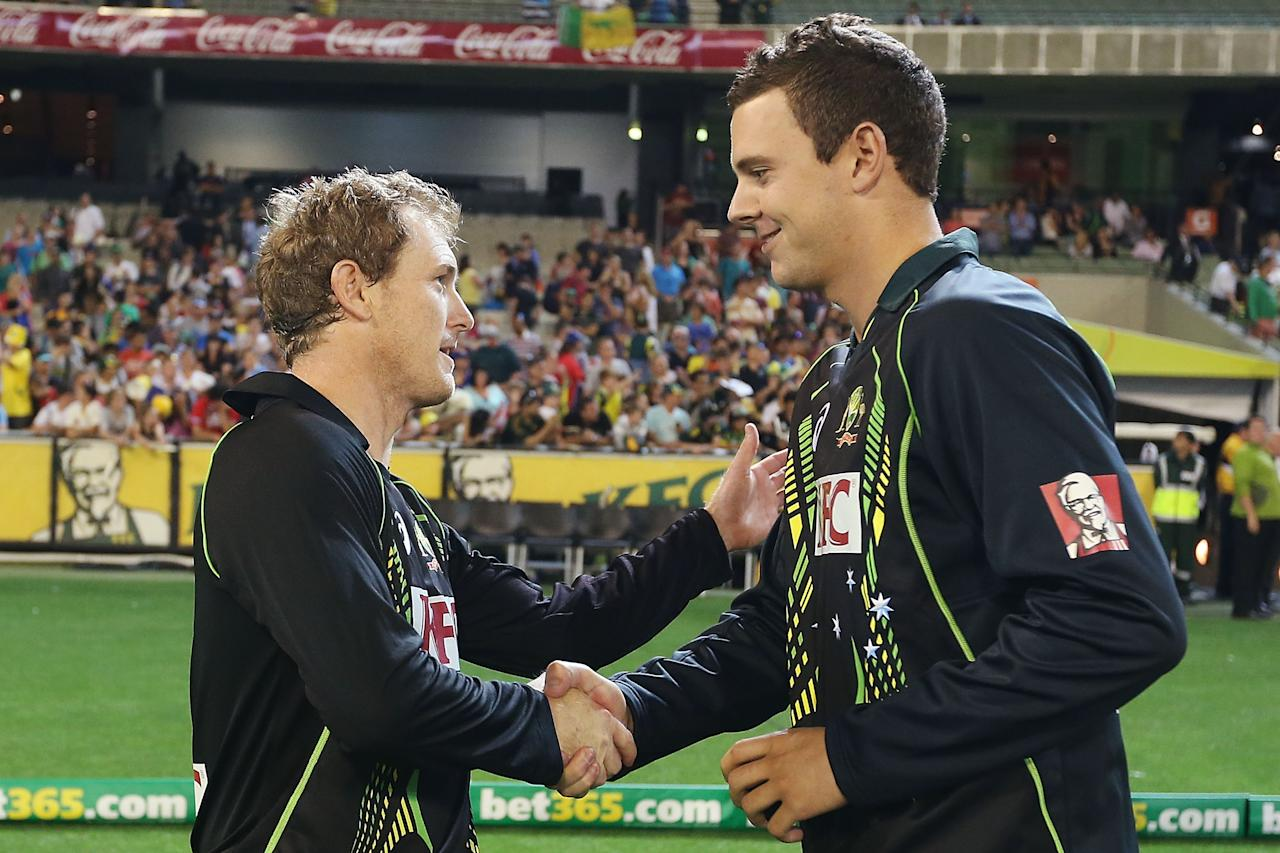 MELBOURNE, AUSTRALIA - JANUARY 31:  George Bailey (L) of Australia congratulates Josh Hazelwood for getting Man Of The Match during two of the International Twenty20 series between Australia and England at the Melbourne Cricket Ground on January 31, 2014 in Melbourne, Australia.  (Photo by Michael Dodge/Getty Images)