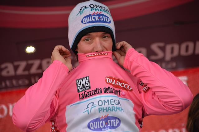 Colombia's Rigoberto Uran celebrates on podium after retaining the pink jersey of leader of the race during the 15th stage of the Giro D'Italia cycling race from Valdengo to Plan di Montecampione, Italy, Sunday, May 25, 2014. (AP Photo/Gian Mattia D'Alberto)