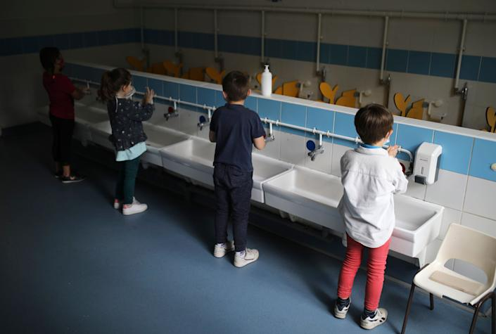 Children wash their hands at the Saint-Tronc Castelroc primary school in Marseille, France, on May 14.