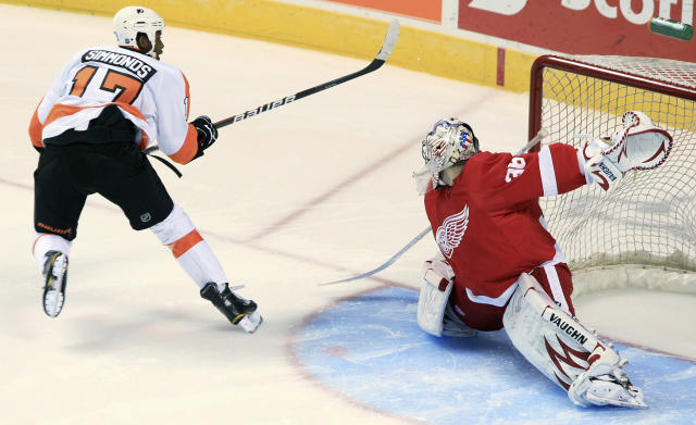 FILE - In this Sept. 22, 2011, file photo, Philadelphia Flyers' Wayne Simmonds scores on Detroit Red Wings goalie Jordan Pearce during the shootout of a preseason NHL hockey game in London, Ontario. In this 2011 game, Flyers forward Wayne Simmonds had a banana thrown at him. (Dave Chidley/The Canadian Press via AP, File)