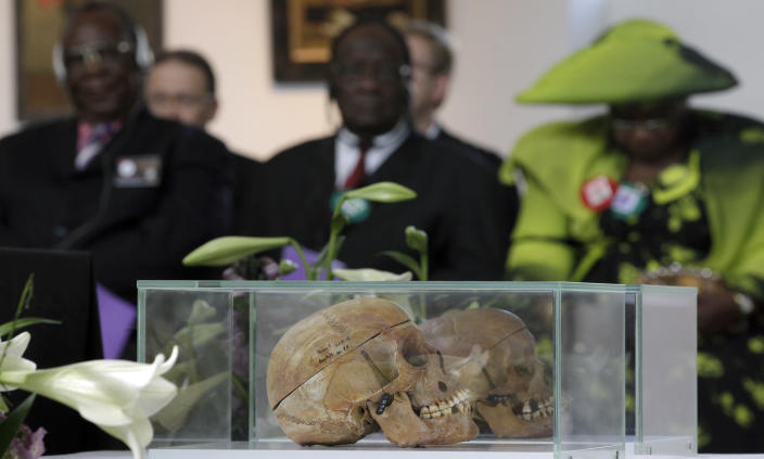 FILE - In this Thursday, Sept. 29, 2011 file photo skulls of Ovaherero and Nama people are displayed during a devotion attended by representatives of the tribes from Namibia in Berlin, Germany. Germany has reached an agreement with Namibia that will see it officially recognize as genocide the colonial-era killings of tens of thousands of people and commit to spending a total of 1.1 billion euros ($1.3 billion), largely on development projects. (AP Photo/Michael Sohn)