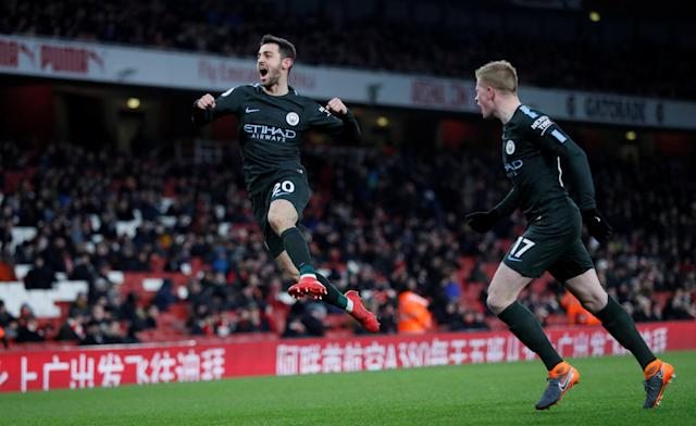 """Soccer Football - Premier League - Arsenal vs Manchester City - Emirates Stadium, London, Britain - March 1, 2018 Manchester City's Bernardo Silva celebrates scoring their first goal with Kevin De Bruyne REUTERS/David Klein EDITORIAL USE ONLY. No use with unauthorized audio, video, data, fixture lists, club/league logos or """"live"""" services. Online in-match use limited to 75 images, no video emulation. No use in betting, games or single club/league/player publications. Please contact your account representative for further details. TPX IMAGES OF THE DAY"""