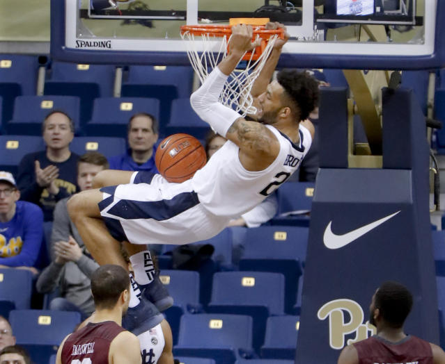 Terrell Brown (21) dunks as against Maryland Eastern Shore during the second half of an NCAA college basketball game, Saturday, Dec. 15, 2018, in Pittsburgh. Brown was given a technical foul for hanging onto the rim. Pittsburgh won 78-43.(AP Photo/Keith Srakocic)