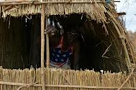 A straw hut provides the quarters for this soldier (AFP Photo/TONY KARUMBA)