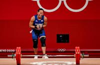 <p>Hidilyn Diaz becomes overwhelmed with emotion as she brings home the gold to the Philippines — the country's first gold medal — and sets a new Olympic record of lifting 127kg in the clean and jerk during the women's 55kg group A weightlifting final at the Tokyo International Forum on July 26.</p>