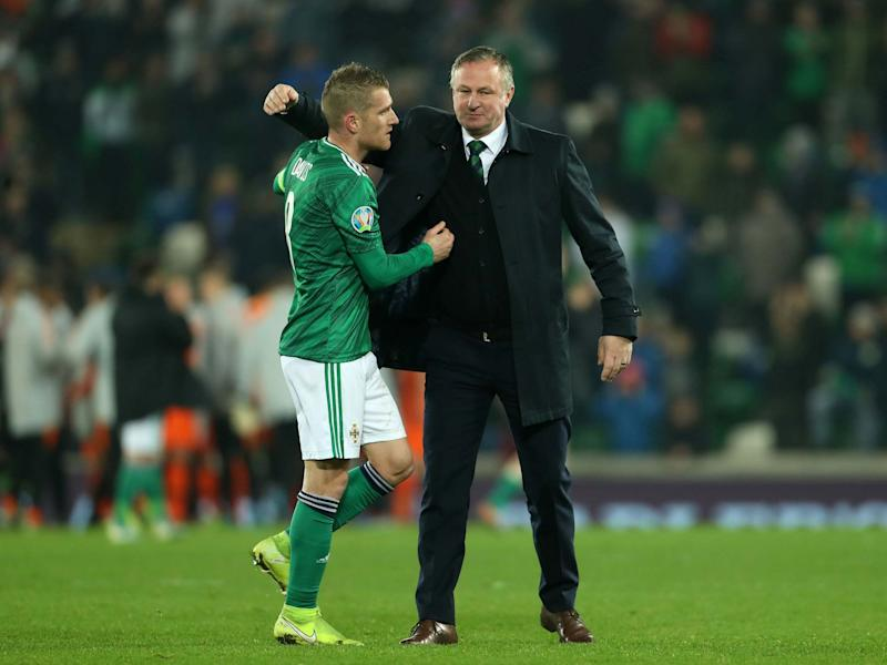 Northern Ireland's Steven Davis with manager Michael O'Neill: PA
