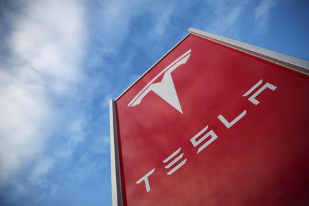 A Tesla dealership is seen in West Drayton, just outside London, Britain, February 7, 2018. REUTERS/Hannah McKay