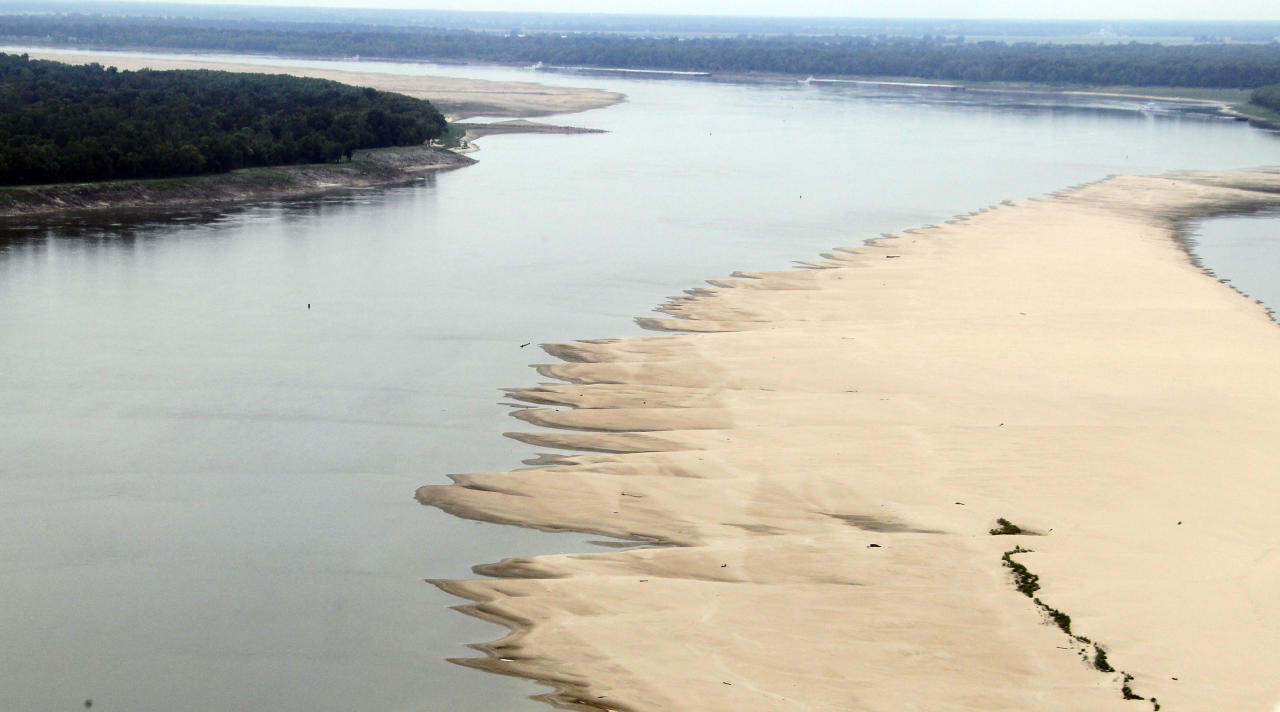 A lowering river allows the sand bars to emerge in the Mississippi River near Greenville, Miss.,Tuesday, Aug. 21, 2012. Officials with the U.S. Army Corps of Engineers say low water levels that are restricting shipping traffic, forcing harbor closures and causing towboats and barges to run aground on the Mississippi River are expected to continue into October. (AP Photo/Rogelio V. Solis)