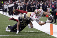 San Francisco 49ers tight end George Kittle (85) dives to the pylon for a touchdown against New Orleans Saints linebacker Craig Robertson (52) in the second half an NFL football game in New Orleans, Sunday, Dec. 8, 2019. (AP Photo/Brett Duke)