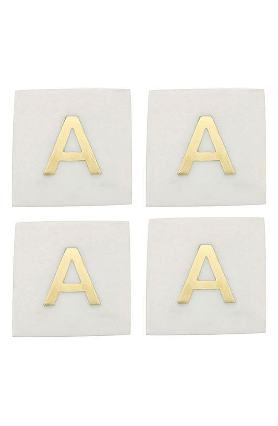 """These monogrammed marble coasters are classy with a capital C. $34, Nordstrom. <a href=""""https://www.nordstrom.com/s/be-home-set-of-4-monogram-marble-coasters/5691356"""" rel=""""nofollow noopener"""" target=""""_blank"""" data-ylk=""""slk:Get it now!"""" class=""""link rapid-noclick-resp"""">Get it now!</a>"""