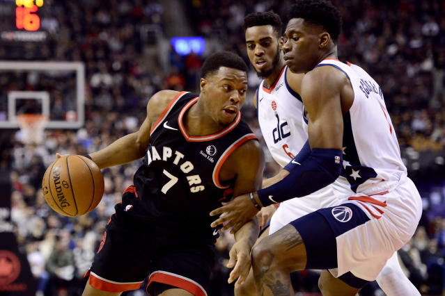Toronto Raptors guard Kyle Lowry (7) drives to the net past Washington Wizards guard Admiral Schofield, right, during the first half of an NBA basketball game Friday, Dec. 20, 2019, in Toronto. (Frank Gunn/The Canadian Press via AP)