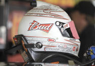 FILE - In this Feb. 16, 2011, file photo, NASCAR driver Kevin Harvick's HANS device equipped helmet rests on the roof of his race car before practice for the Daytona 500 auto race at Daytona International Speedway in Daytona Beach, Fla. The lightweight head restraint co-invented by veteran sports car racer Jim Downing keeps a driver's head from snapping forward violently in a crash and has been credited with saving numerous lives in its two decades of use. (AP Photo/Terry Renna, File)