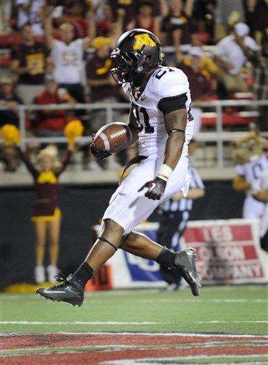 Minnesota's Brock Vereen (21) trots in for his first half touchdown against UNLV during his NCAA college football game at Sam Boyd Stadium, Thursday, Aug. 30, 2012 in Las Vegas. (AP Photo/David Becker)