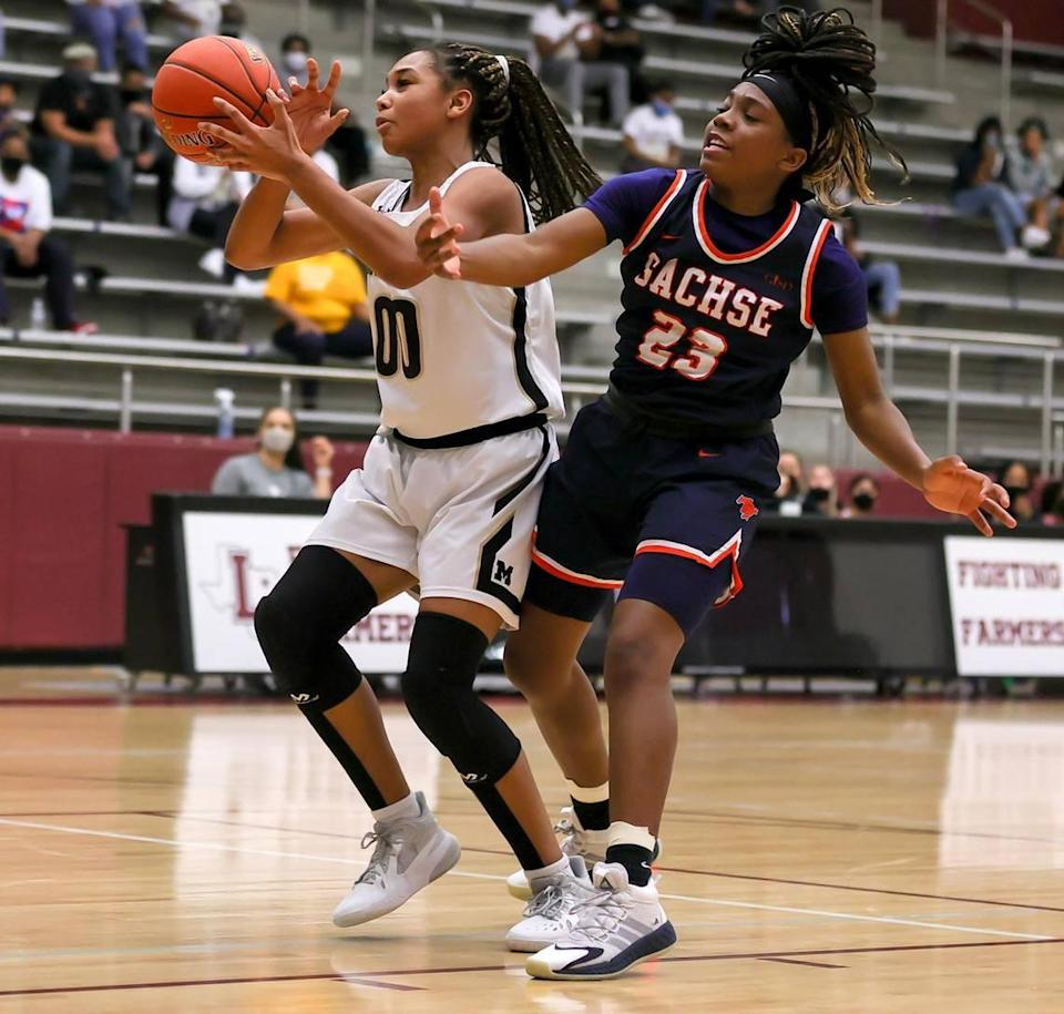Mansfield post Zarria Carter (00) gets fouled by Sachse guard Crislyn Rose (23) during the second half of the 6A Region II Girls Basketball Area -Round 2 played February 23, 2021 at Lewisville High School. (Steve Nurenberg Special to the Star-Telegram)