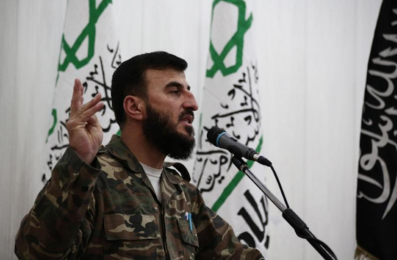 Zahran Alloush, commander of Jaysh al-Islam, speaks during a press conference on June 25, 2014, in the rebel-held Eastern Ghouta region outside of Damascus
