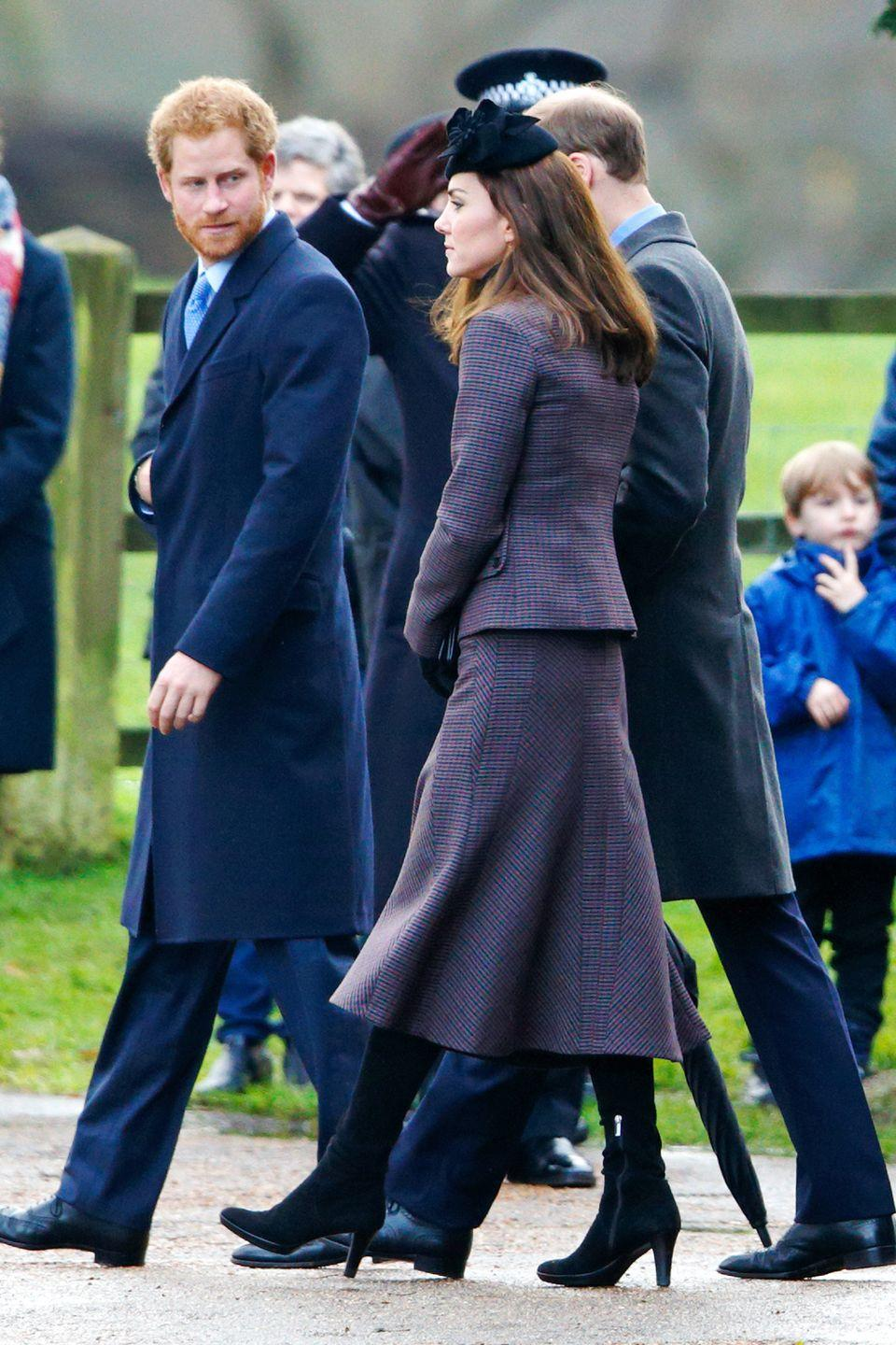 <p>The Duchess attended a post-Christmas service at St. Mary Magdalene Church in a sophisticated, tweed suit by Michael Kors, adding a royal blue hat and gloves to complete the look.</p>
