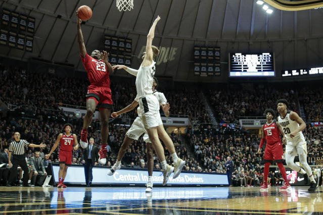Rutgers guard Montez Mathis, left, shoots over Purdue center Matt Haarms during the first half of an NCAA college basketball game in West Lafayette, Ind., Tuesday, Jan. 15, 2019. Purdue won 89-54. (AP Photo/AJ Mast)