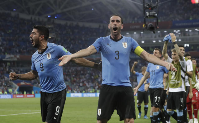 Uruguay's Luis Suarez, left, and Diego Godin celebrate after the round of 16 match between Uruguay and Portugal at the 2018 soccer World Cup at the Fisht Stadium in Sochi, Russia, Saturday, June 30, 2018. (AP Photo/Andre Penner)