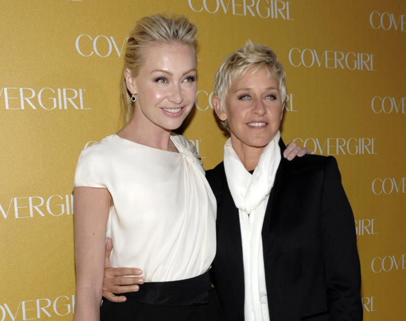 FILE - In this Jan. 5, 2011 file photo, television personality Ellen DeGeneres, right, and actress Portia de Rossi arrive at the COVERGIRL Cosmetics' 50th Anniversary Party in Los Angeles. Prosecutors have charged a woman arrested outside Ellen DeGeneres' home last week with misdemeanor trespassing. District Attorney's spokeswoman Jane Robison says Karen Grace Sjoden is scheduled to be arraigned in a Beverly Hills courtroom Monday, Feb. 14, 2011. (AP Photo/Dan Steinberg, file)