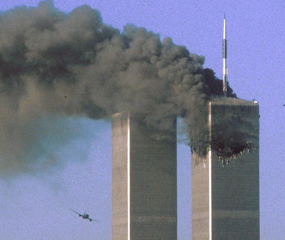 Hijacked United Airlines Flight 175 flies towards the South Tower (Reuters)