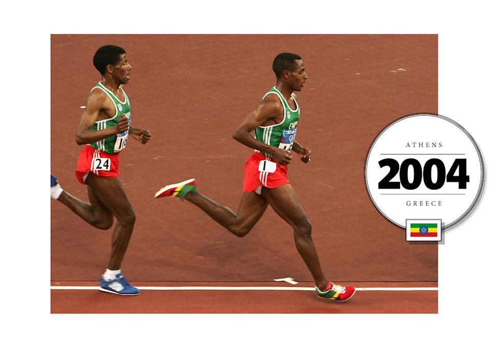 Kenenisa Bekele, representing Ethiopia, wore the most vibrant uniform at the 2004 Summer Olympics in Athens. He wore his country's colors on his feet, too, with custom Nike shoes. (Getty Images)