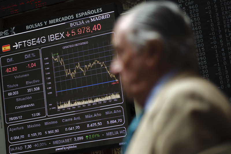 A broker stands near the main display at the Stock Exchange in Madrid, Monday, May 28, 2012. Conservative Spanish Prime Minister Mariano Rajoy was adamant Monday that Spain's bank sector would not need an international rescue as concern over the bailout fund for nationalized lender Bankia sent that bank's stock price plummeting while Spain's borrowing costs soared. (AP Photo/Daniel Ochoa de Olza)