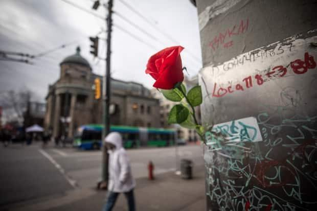 A rose in memory of those lost to the opioid crisis is pictured at the intersection of East Hastings Street and Main Street in the Downtown Eastside of Vancouver, British Columbia on Thursday, Feb. 11, 2021.